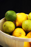 limes with lemons in a basket