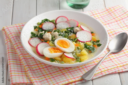 Foto Murales Spring soup with spinach, radish, and eggs