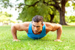 Quadro Fitness man exercising outdoors in the park, healthy lifestyle and wellness concept