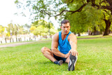 Fitness man exercising outdoors in the park, healthy lifestyle and wellness concept