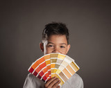 kid holding a pantone palette on a gray background - 248541437