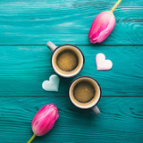 Fototapeta Tulipany - Two coffee cups, hearts and flowers. Valentine day © tenkende