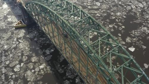 Aerial video bridge over glacier water