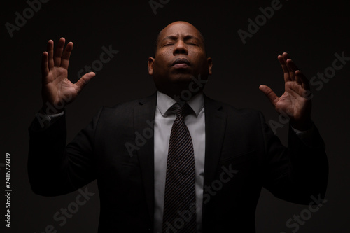 African American Christian Man Praying and Seeking Guidance from God © cmlndm