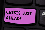 Handwriting text writing Crisis Just Ahead. Concept meaning time of intense difficulty or danger coming soon Keyboard key Intention to create computer message pressing keypad idea - 248591827