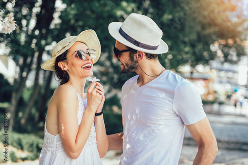 Couple in love. Romantic couple enyojing in moments of happiness in the city park. Love and tenderness, dating, romance. - 248593619