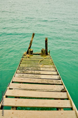 Wooden stairs lead to the sea © Niyom