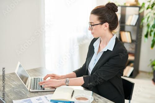 Leinwanddruck Bild Confident Businesswoman at Workplace