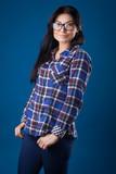 Beautiful sexy lady fashion pretty woman model pose wear plaid shirt on the blue studio background - 248618485