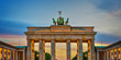 Brandenburg gate illuminated at sunset , Berlin, Germany