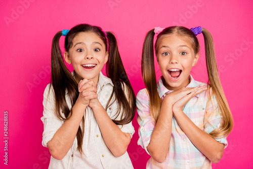 Leinwanddruck Bild Close up photo two little age girls hands arms palms together yell scream shout want buy buyer tablet telephone app pda wearing casual jeans denim checkered plaid shirts isolated rose vivid background