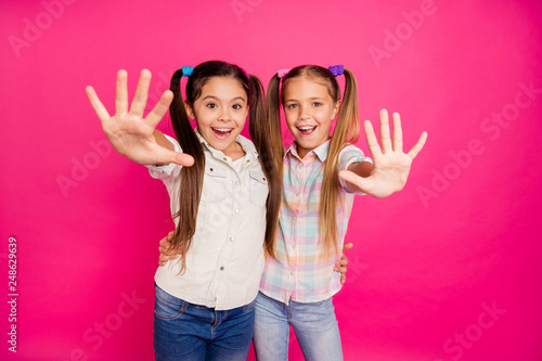 Leinwandbild Motiv Close up photo two small little age she her girls hands arms palms counting fingers school lesson class wearing casual jeans denim checkered plaid shirts isolated rose vibrant vivid background