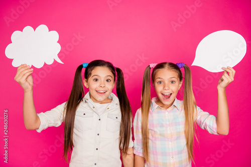 Leinwandbild Motiv Close up photo two little age she her girls hold hands arms paper white clouds promo banner new project wear casual jeans denim checkered plaid shirts isolated pink rose vibrant vivid background