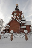 wooden russian orthodox church in snowy winter