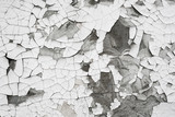 Texture of gray concrete wall with peeling white paint. Weathered uneven rough surface. Perfect for background and grunge design. - 248632840