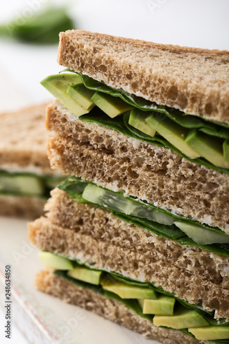 Healthy vegan sandwiches  with green vegetables and greens