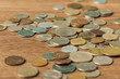 selective focus of laid different coins on wooden blurred background