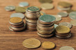 selective focus of coins stacks on wooden and blurred background