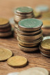 selective focus of stacks with different coins on wooden background