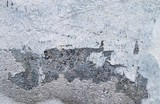 Close up of cracks in aged weathered cement and concrete walls of different buildings