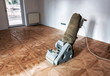 Sanding hardwood floor with the grinding machine. - 248656057