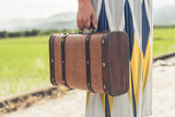 woman holding a suitcase - 248657039