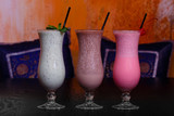 Three Indian healthy coctails  - wthite, pink and coffe with yogurt and rice - 248661016