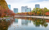 View from pond of Osaka castle to city