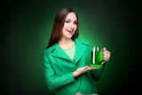 St. Patrick's Day. Beautiful woman holding glass of beer - 248683422