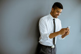 Handsome Afro-American businessman with mobile phone - 248684007