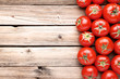 Fresh and ripe tomatoes on brown wooden table