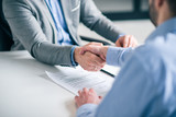 Business partnership concept. Cropped image of two businessmen handshake. - 248688454