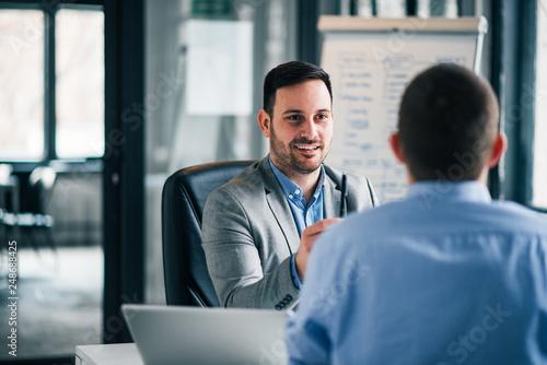 Zobacz obraz Two business men on meeting.