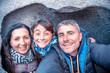 Leinwandbild Motiv Happy family taking a selfie inside a rock