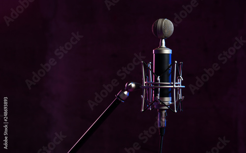 Leinwanddruck Bild Close up studio condenser microphone with  anti-vibration mount live recording neon blue and pink lights