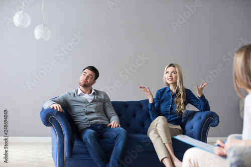 Couple at therapy session with psychologist.