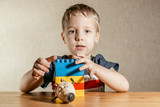 little boy playing with constructor with enthusiasm - 248702699