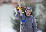Boy playing with airplane in park - 248704649