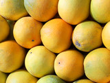 background of many organic oranges for sale at market