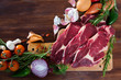 Raw  beef and vegetables assortment on wooden desk, cooking ingredients
