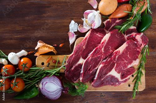 Raw  beef and vegetables assortment on wooden desk, cooking ingredients © JackF
