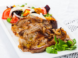 Fried pork meat chops with salad of fried orange and vegetables - 248708071