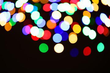 Beautiful colorful lights on dark background. Bokeh effect