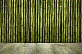 Fototapeta Sypialnia - Empty wooden table and bamboo sticks © digieye