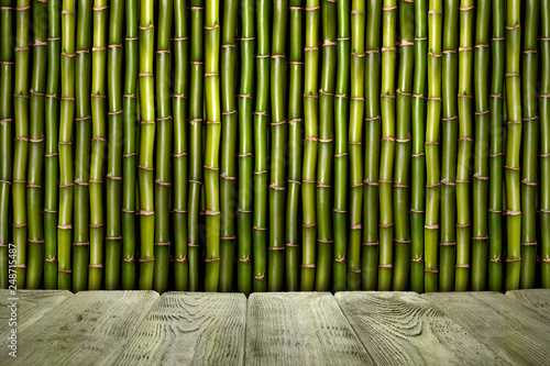 Empty wooden table and bamboo sticks