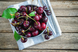 Fresh sweet cherries in a bucket