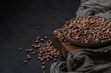 Roasted coffee beans on a dark background. Photo with negative space.