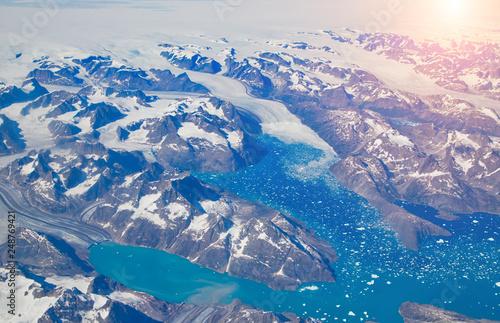 Leinwanddruck Bild Aerial view of scenic Greenland Glaciers and icebergs