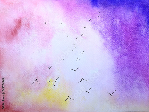 watercolor sunset landscape birds flying in the pink sky. © atichat