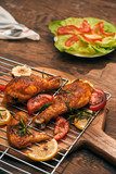 Grilled chicken breast spiced with chili peppers and rosemary - 248791092
